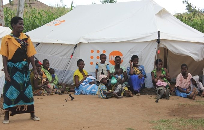 A group of lactating mothers relaxes outside a tent used as a 'safe space' for women and girls at Mpasa camp in Phalombe, Malawi. Photo: UNFPA Malawi