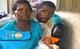 Tina, Antonio, and baby Joana at their new temporary home. © UNFPA Mozambique